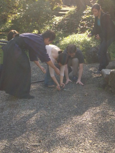 Hiroki, Maihien, Jake and I preparing a shot, which somehow involves the pebbles on the ground.